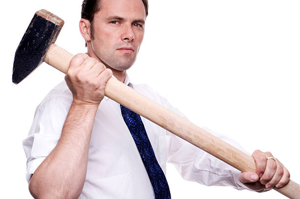 business man with sledgehammer stock photo
