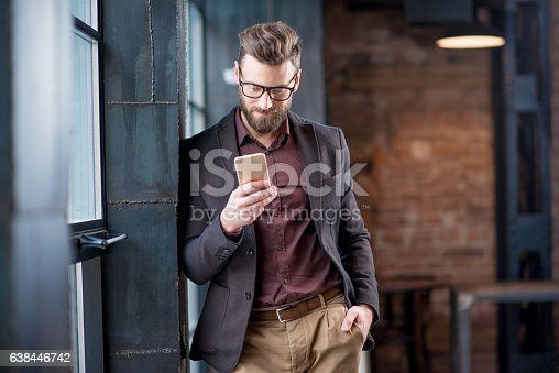 istock Business man with smart phone 638446742