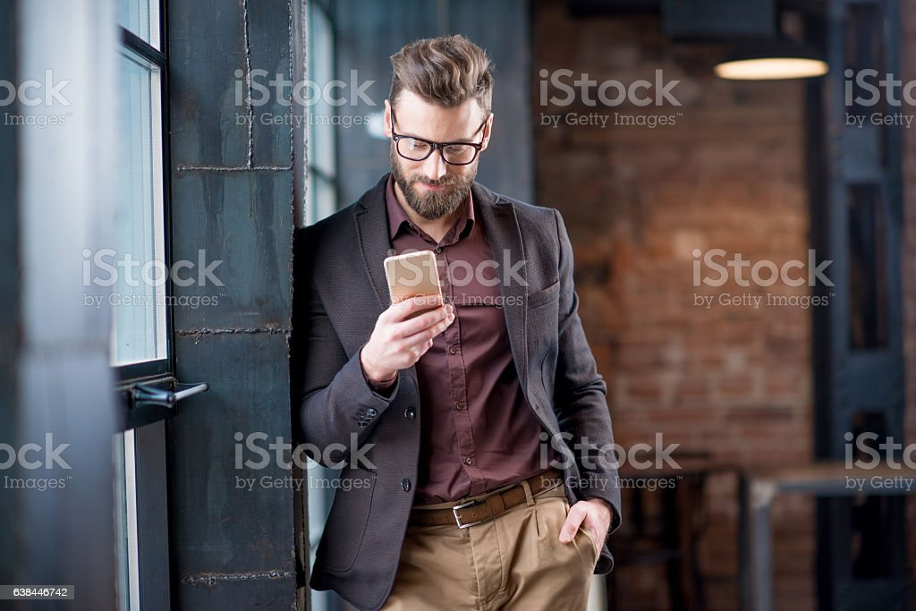 Business man with smart phone stock photo