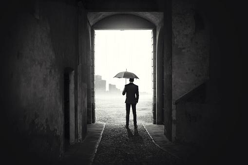 Business Man with umbrella waiting stop raining