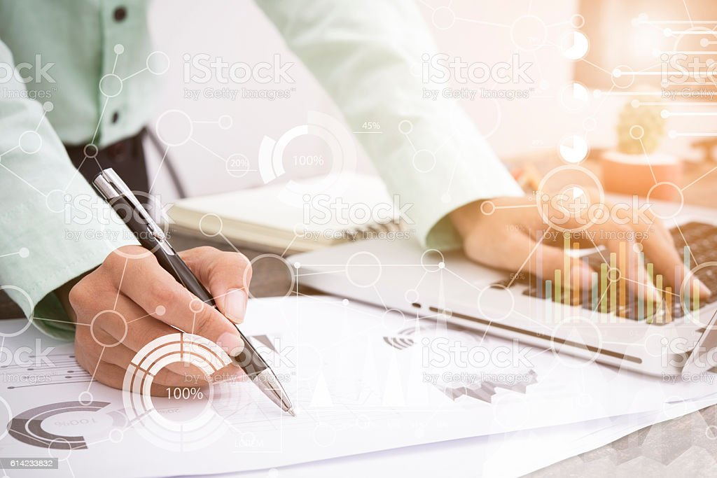business man working about business investment report on desk office. stock photo