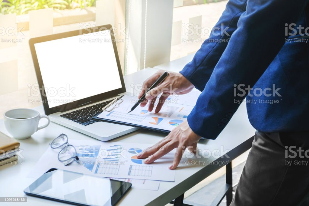 business man working analysis data documents of stock market company...