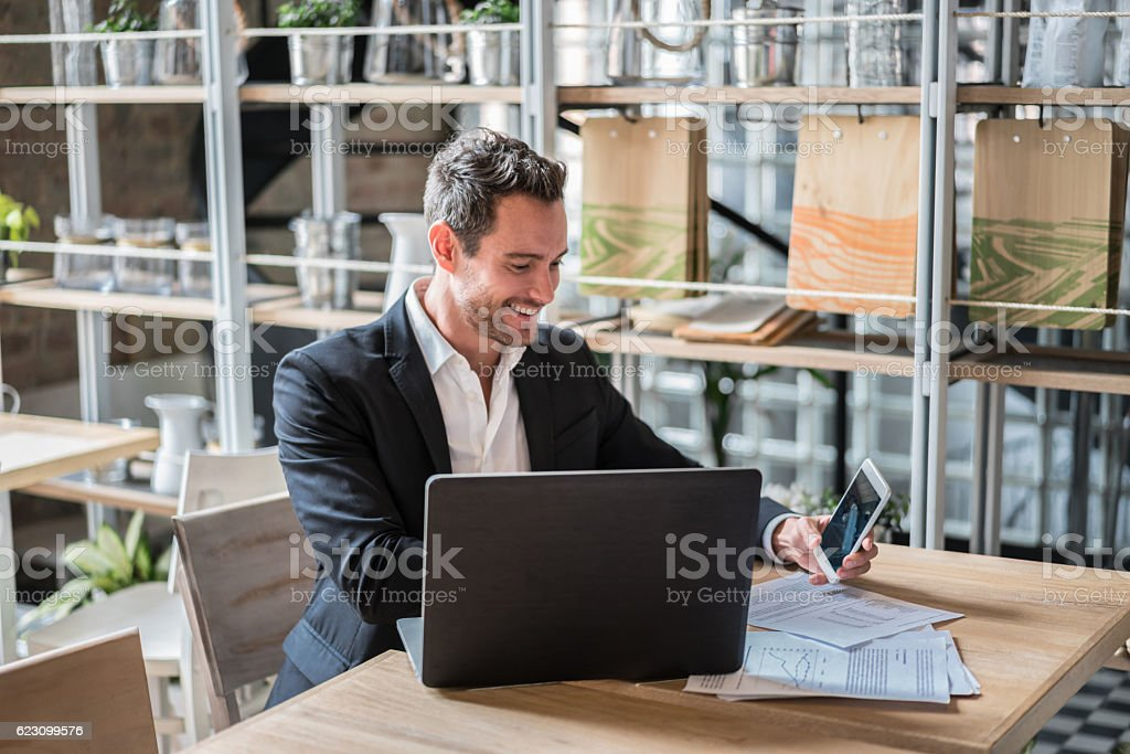 Business man working at a restaurant stock photo