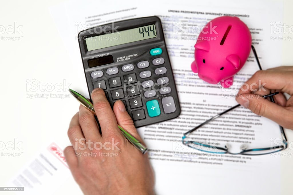 Business man working at office with calculator and documents on his desk stock photo
