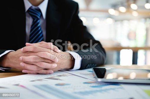 istock Business man working at office with laptop and documents on his desk, consultant lawyer concept 695450272