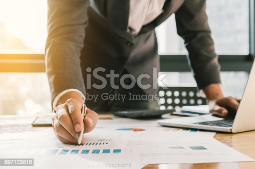 istock Business man working at office with laptop and documents on his desk, consultant lawyer concept 697123516