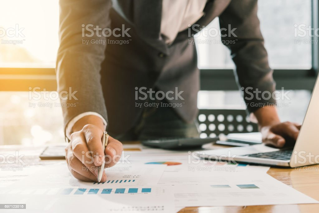 Business man working at office with laptop and documents on his desk, consultant lawyer concept stock photo