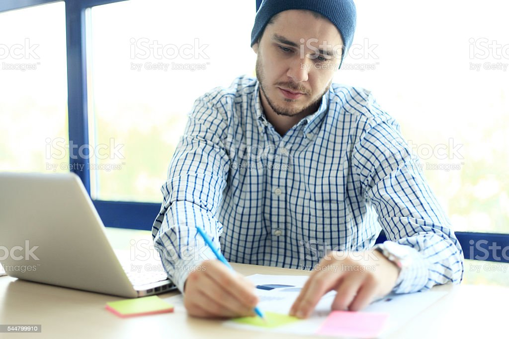 Business man working at office with laptop and documents stock photo