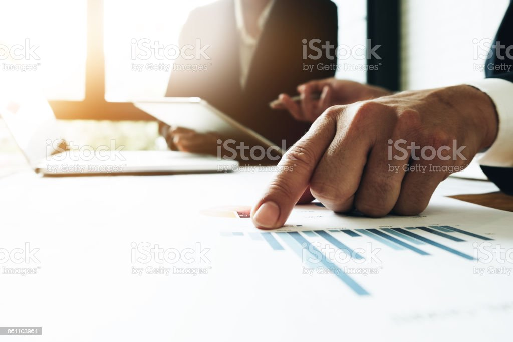 Business man working at office with laptop and documents,businessmen using documents at meeting, Support Concept, Business team royalty-free stock photo