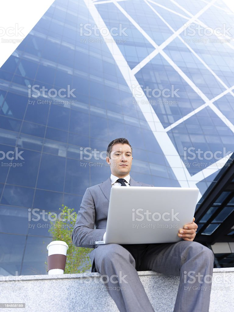 Business man working on his laptop royalty-free stock photo