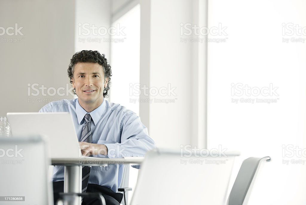 Business man working on laptop stock photo