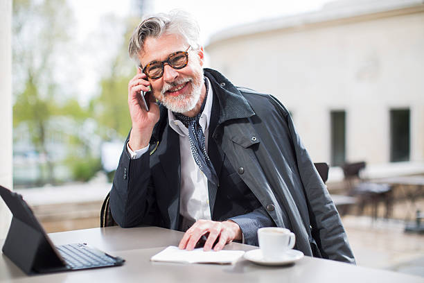 Business man working outdoors near the eiffel tower stock photo