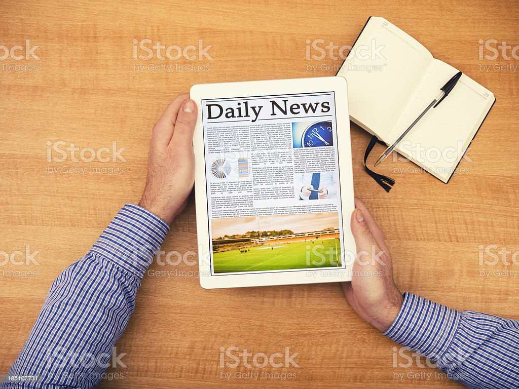 Business man working reading a newspaper on digital tablet royalty-free stock photo