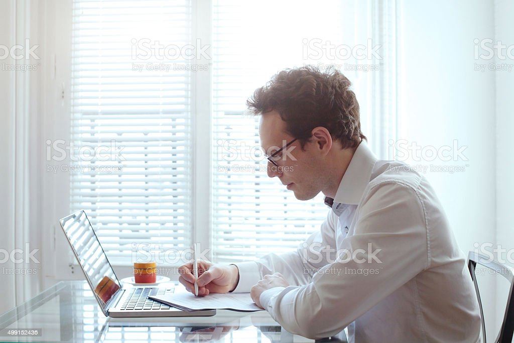 business man working with documents in his office stock photo