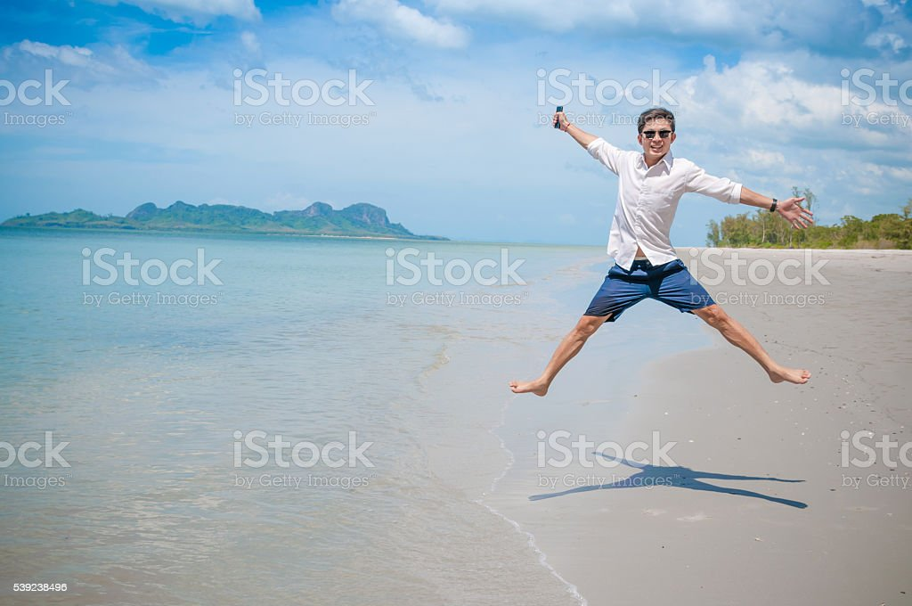 Business man working with laptop and smartphone beach background royalty-free stock photo