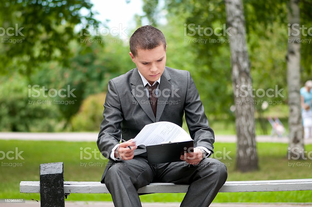 business man working with papers at park. Student royalty-free stock photo