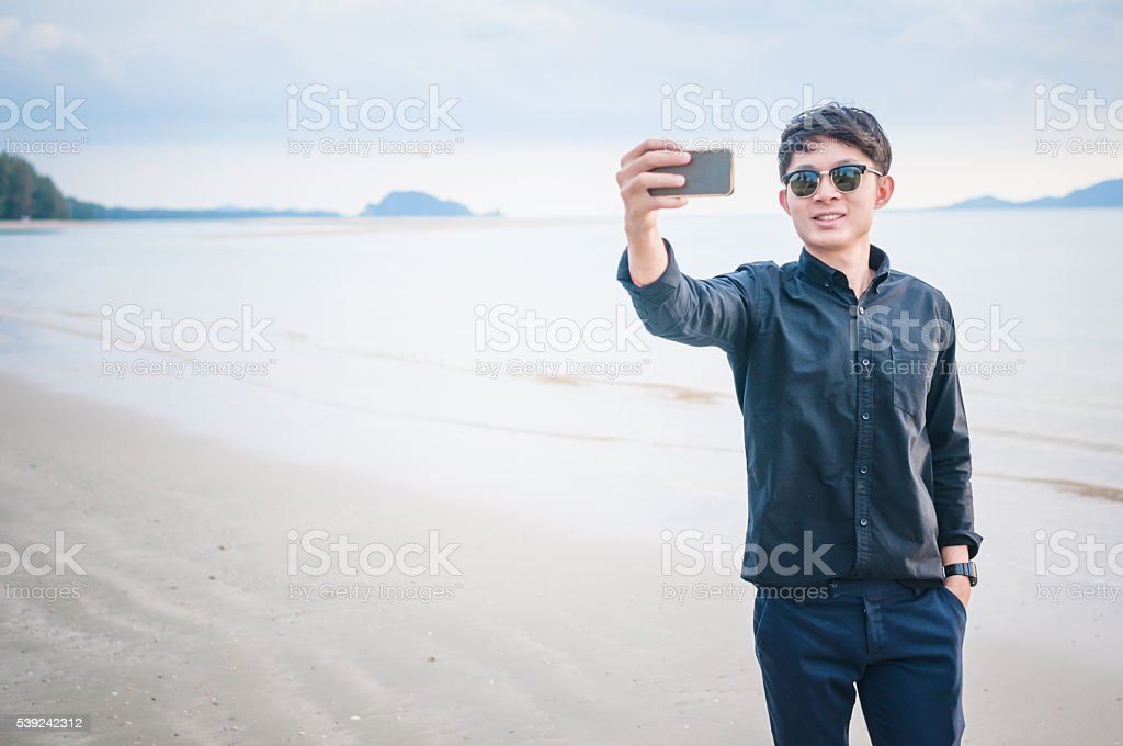 Business man working with smartphone beach background royalty-free stock photo