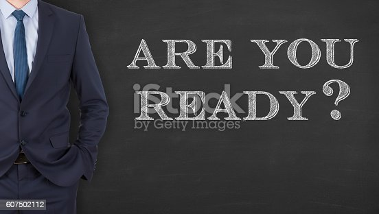 istock Business Man Writing  Are You Ready on Chalkboard 607502112