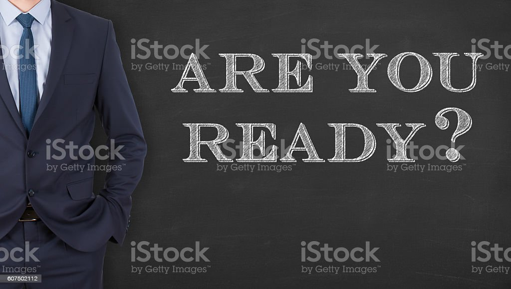 Business Man Writing  Are You Ready on Chalkboard stock photo