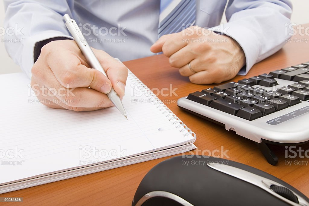 Business man writing in a notebook royalty-free stock photo