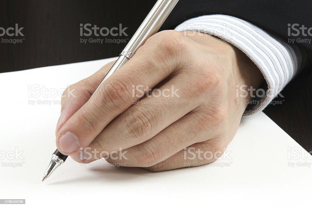 Business man writing royalty-free stock photo