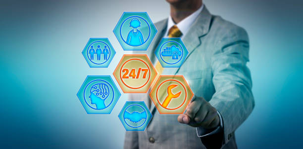 Business Manager Activating 24/7 Managed Services stock photo