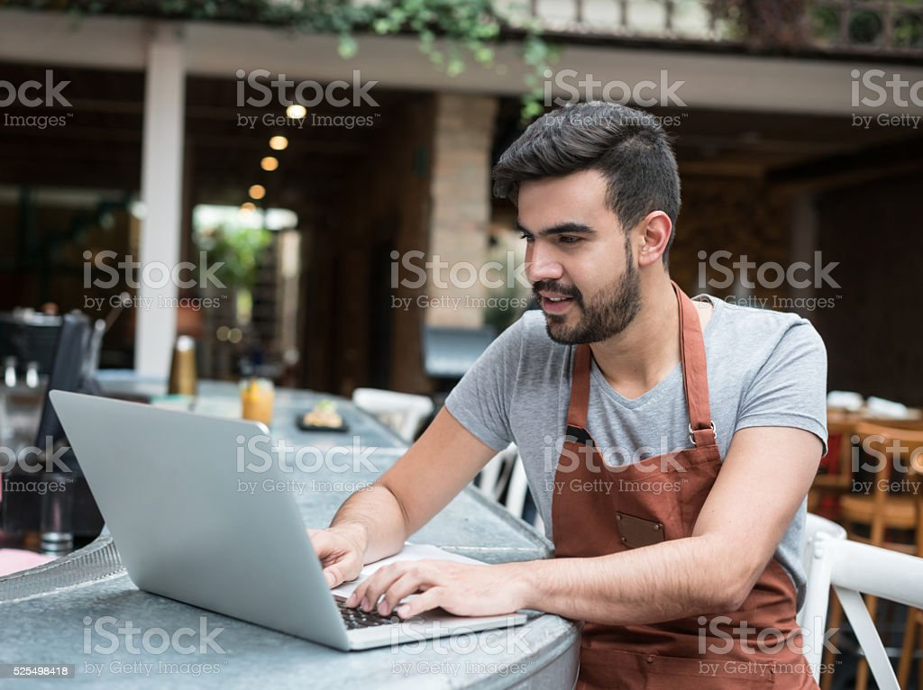 Business manager doing the books at a restaurant stock photo