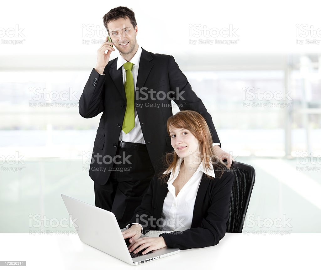 business manager partner work and smile at office with laptop royalty-free stock photo