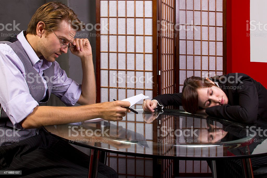 Business Manager Reviewing a Sleepy Lazy Worker Job Performance royalty-free stock photo