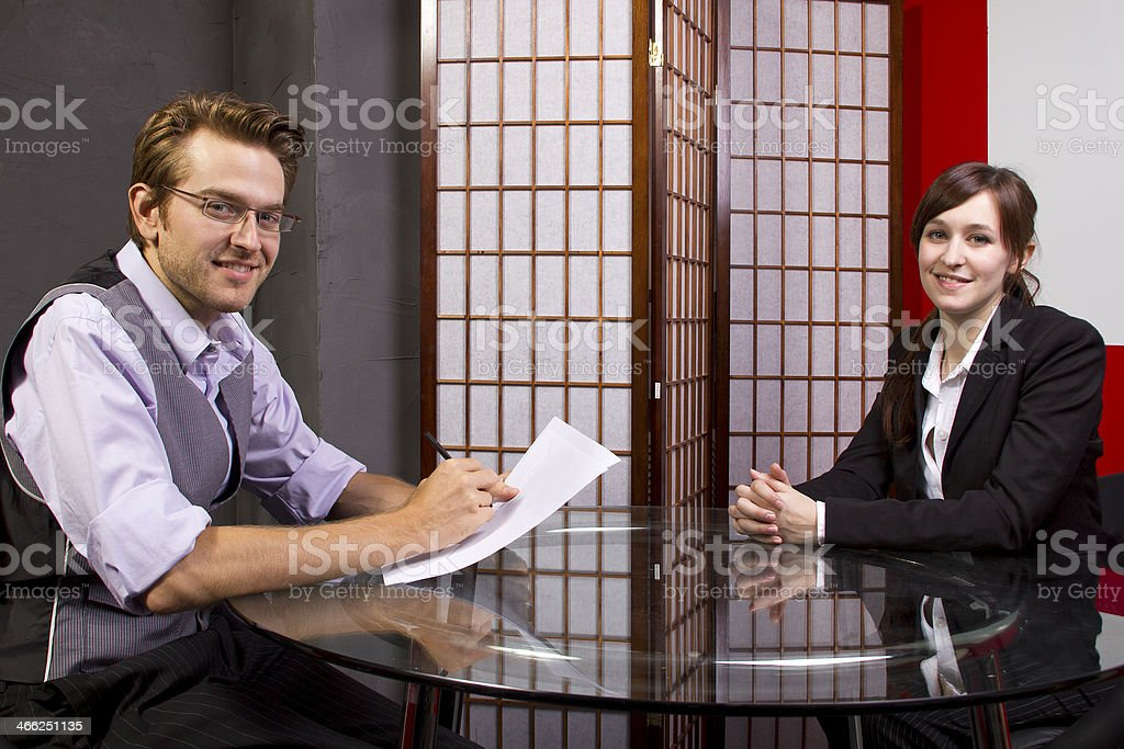 Business Manager Reviewing Employees Job Performance royalty-free stock photo