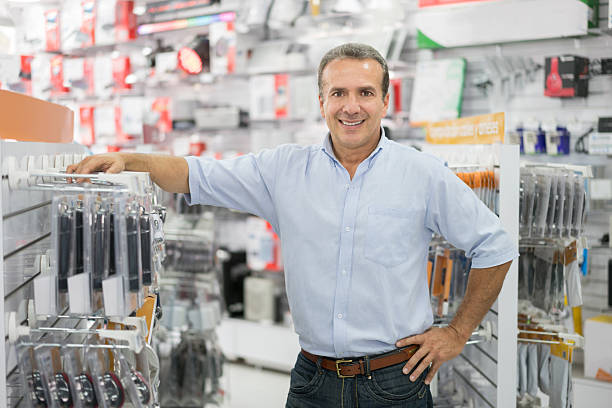 Business manager running a tech store stock photo
