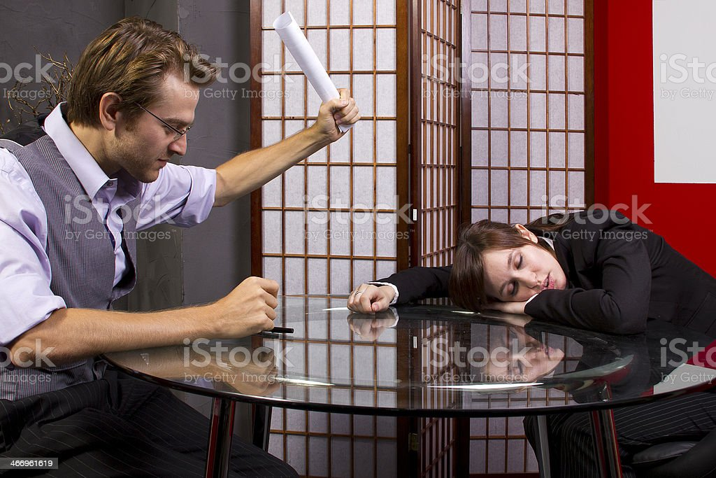 Business Manager Waking Up a Sleepy Lazy Worker royalty-free stock photo