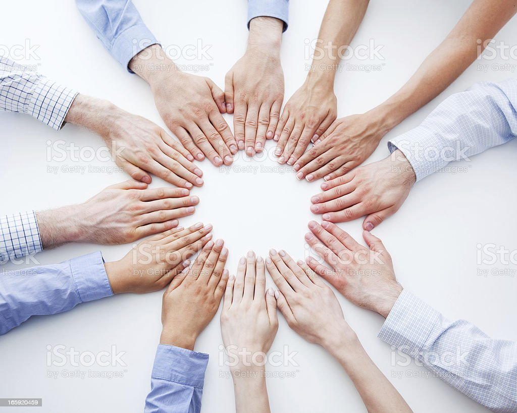 Business Mandala Teamwork concept. 12 hands of business people forming circle. Elevated view, white background. Agreement Stock Photo