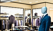 Business mannequin in clothing store.