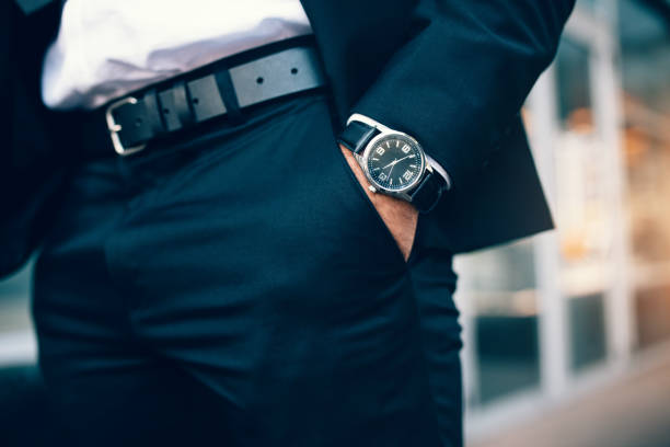 Business man's hand in pocket wearing a watch stock photo