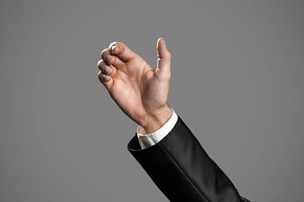 business man's hand to hold something - gripping stock photos and pictures