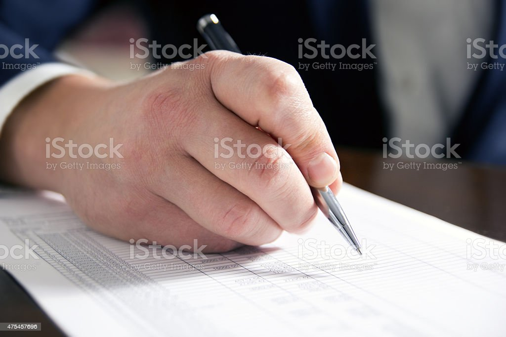 Business man's hands signing business documents. Signing papers. stock photo
