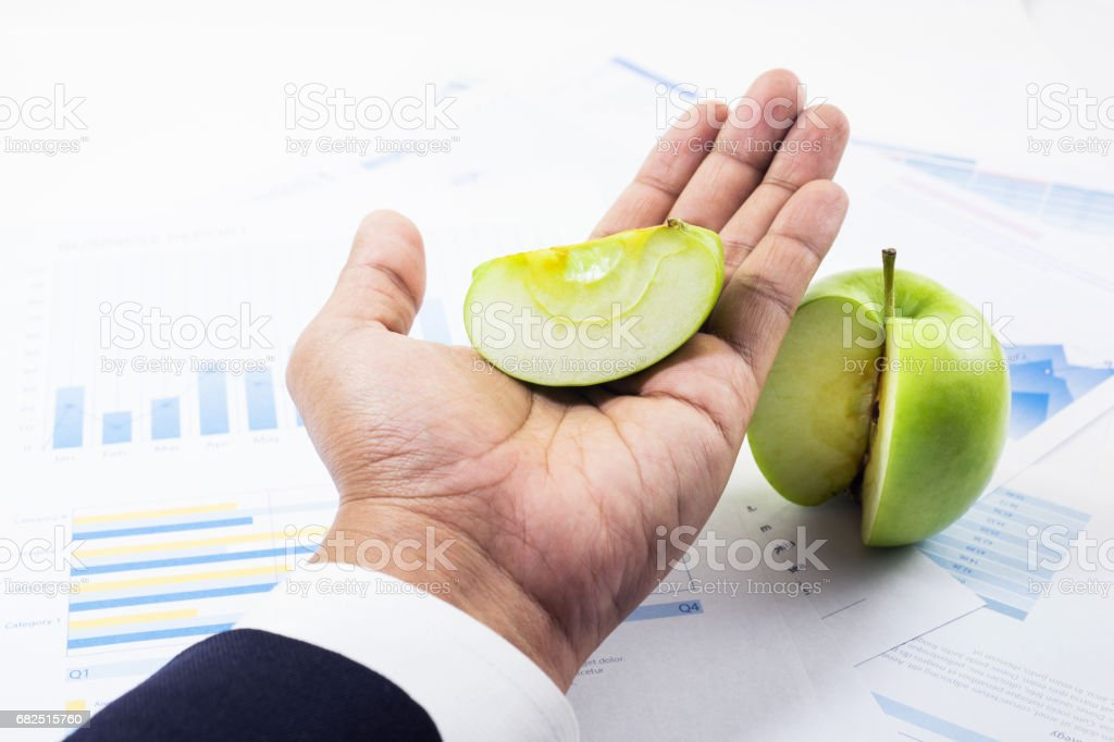 Business market share concept with businessman and green apple. royalty-free stock photo