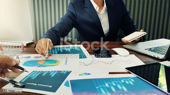 865596974istockphoto Business marketing and finance working busy, analyzing sales data and economic growth graph chart. 1182774849