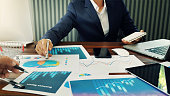 istock Business marketing and finance working busy, analyzing sales data and economic growth graph chart. 1182774849