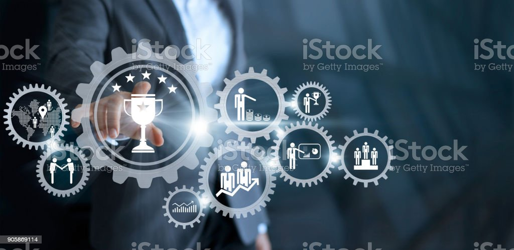 Business mechanism concept. Businessman touching trophy winner successful and business processes workflows in gears icons on virtual screen stock photo