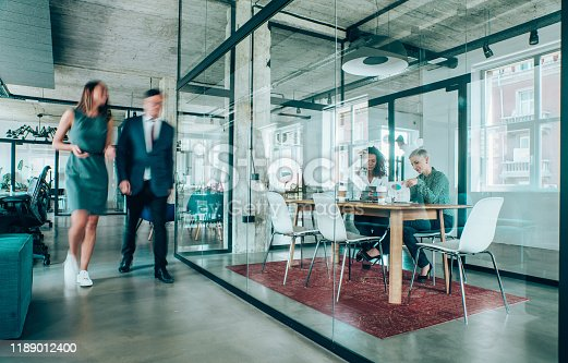 1163429625istockphoto Business meeting at busy corporate office. 1189012400
