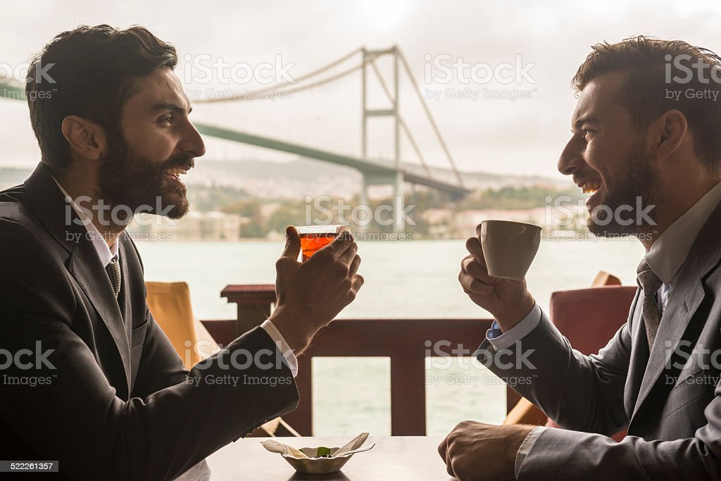 Business meeting at the Bosphorous Bridge, Istanbul. stock photo
