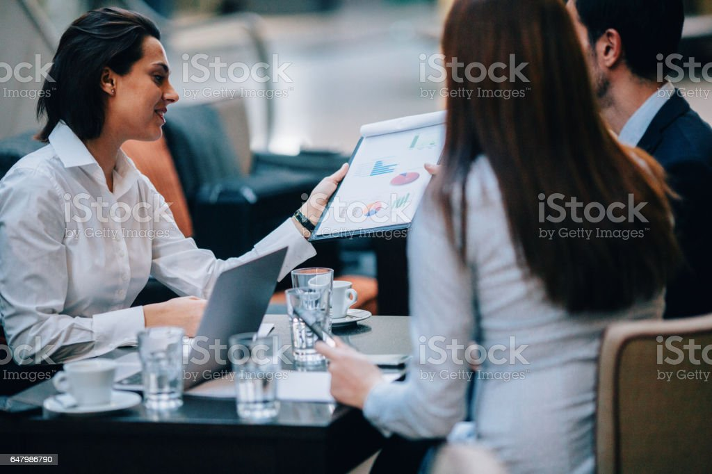 Business meeting at the cafe stock photo