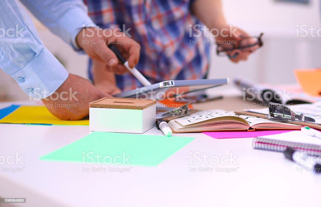 Business meeting at the table shaking hands conclusion of the royalty-free stock photo