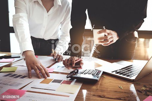 925942192istockphoto business meeting, business woman Explain analyze the company's sales plan  and business owner by use calculator with laptop computer on wood desk in conference. 910343676