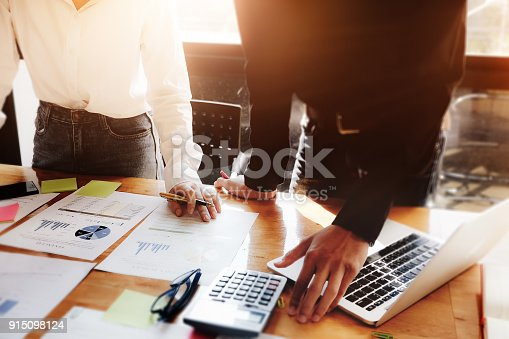 881542122istockphoto business meeting, business woman Explain analyze the company's sales plan  and business owner by use laptop computer  and calculator on wood desk in conferance. 915098124