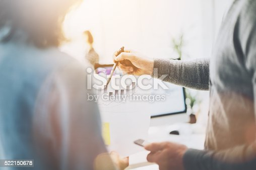 istock Business meeting, closeup photo chart holding hands. Photo managers crew 522150678