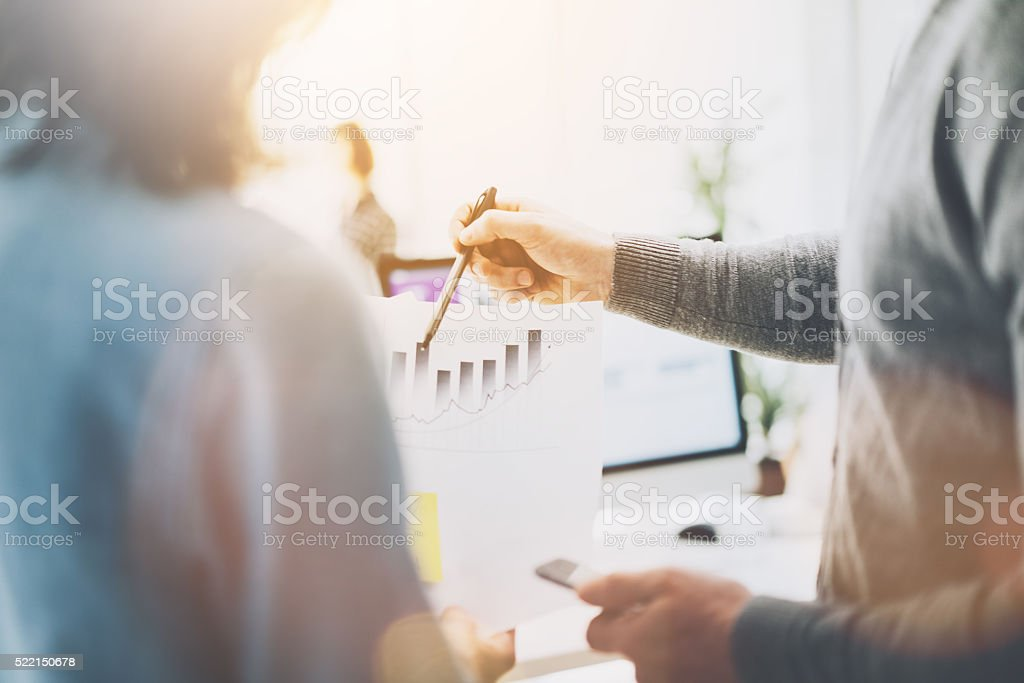 Business meeting, closeup photo chart holding hands. Photo managers crew stock photo