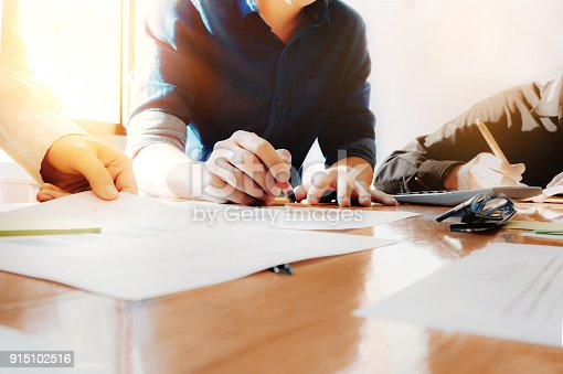881542122istockphoto business meeting concept, calculate financial & budget & stock market data document with calculator in working on wood desk in office. 915102516